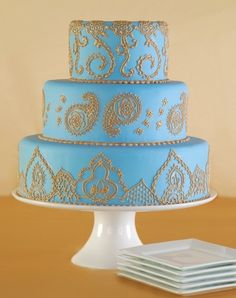 blue and gold mehndi wedding cake...pretty but in cupcakes instead! :)
