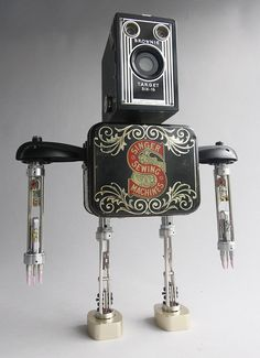 Singer -Brian Marshall makes cute looking robots out of old greasers, aluminum spoons, pencil and other throw away scraps. Adoptabots are cute little sculptress, created by Delaware-based artist, Brian Marshall, using various discarded objects.