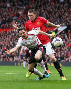 Manchester United 0-3 Liverpool: United concede a second penalty as Phil Jones pushes over Joe Allen.