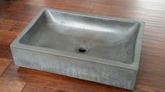 This is a beautiful 23 rectangular shaped vessel sink with rounded bowl corners. Beautiful and strong. We add AR glass fiber reinforcement to our high strength concrete cast mix, (over 11,000 psi) and use a commercial penetrating sealer specifically made for high strength concrete. Outside sink dimensions: 23 × 15 × 5 These sinks are beautifully crafted and partially diamond polished for a slight 2 tone color for and older look with a modern design. The sink color shown is carbon. Multip...