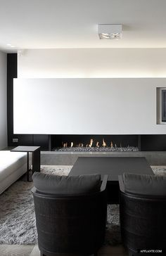 ♂ Minimalist black and white interior living room space with modern fireplace…