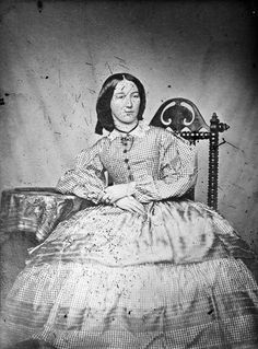 Woman wearing a crinoline dress, 1860 um petty.. but the dress is not crinoline the crino is under the dress  it what makes it lampshade shaped