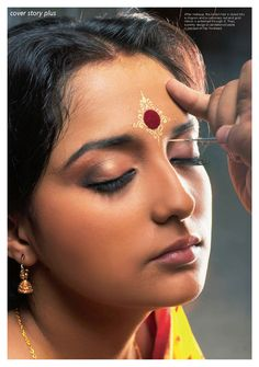 Chandan or bindi decorations made using fresh sandalwood paste is one of the most important part of a bengali brides make up for the wedding.