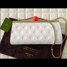 NWT Kate Spade Golf Clutch / Shoulder Handbag Brand new Kate Spade GOLF Clutch and shoulder bag. White patent leather with Golf ball design. Top handle has golf ball. Gold trim and chain. Tan interior with credit card slot. Comes with pouch. Selling for over $200 on eBay. Kate Spade Bags Clutches & Wristlets