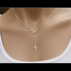 """Silver Sideways Infinity Tiny Cross Necklace New Silver Sideways Infinity Cross Blessed Simple Tiny Necklace. Chain is 925 Sterling Silver . Pendant is Silver Plated. Chain Size 14"""", 16"""", 18"""", 20"""", 22"""". Traditional Chain Size is 18 inches. Let me know if you need a different Chain Size. Jewelry Necklaces"""