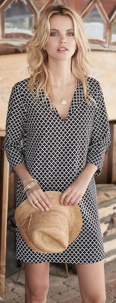 A quatrefoil print adds sophisticated graphic appeal to an effortless stretch-woven shift with split-neck styling and three-quarter sleeves.
