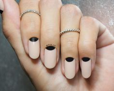 classy nude nails with black halfmoon accents.