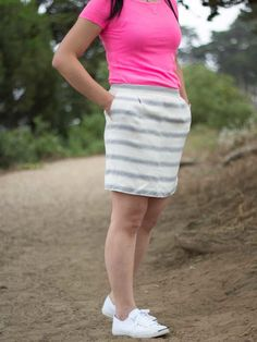 Neon pink tee | white & gray striped skirt | white tennis shoes | www.shoppingmycloset.com     #jcrew #jackpurcell