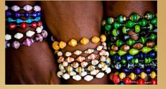 """These bangle bracelets are handmade by women in Uganda. The beads are actually rolled from recycled paper. Absolutely gorgeous, and good for the world!! You can buy online or host a """"Bead Party."""" $5.00"""