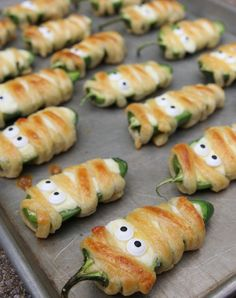 Jalapeno Popper Mummies: A grown-up treat perfect for Halloween.