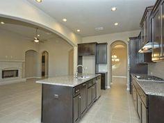 Pristine new kitchen in an equally pristine new build at 1514 Ambling Trl, Cedar Park Property Listing: MLS® #4756710 #newbuild #morelandproperties #lakeaustin #tile #granitecountertops #austinrealestate