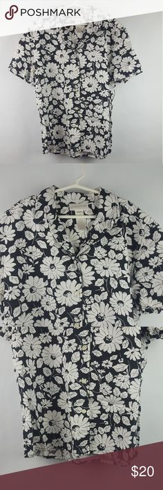 Jones New York women's shirt white black flowers M6  This is a Jones New York Women's Shirt. It's black with white flower pattern. It's short sleeved and size medium. It's a casual wear  Top . The chest measurement is 21 and a half inch and the hem the collar measurement is 25 in . I have seen no damage on this garment.Any questions please message me! Please check out the photos thank you! Jones New York Tops Button Down Shirts