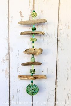 Not sure how this is a wind 'chime'......but I'd add a cute little bell or actual chime to this.  Love the use of green (my favourite colour!) and bits of driftwood together.