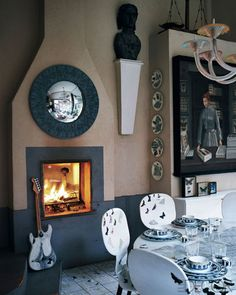 Milan Homes - Barnaba Fornasetti Interiors - ELLE DECOR Love the convex mirror over the fireplace