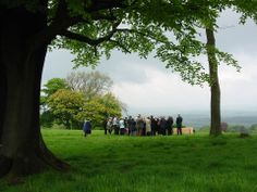 A graveside congregation at Cardiff Natural Burial Meadow.