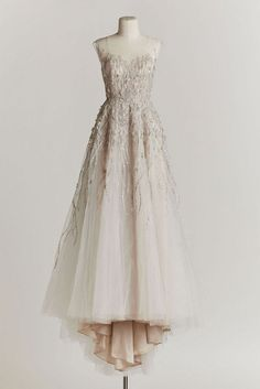 Vintage Wedding Dress: This BHLDN exclusive, designed by Watters, is created with delicate strips of metallic tulle of divine layers of delicate tulle. BHLDN talks about this gown as one with a fairy tale ending, and we agree!