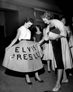 A young lady shows off her Elvis circle skirt. c.1950s