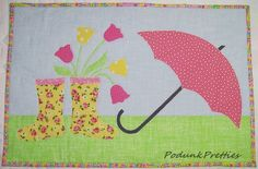Use free applique designs to create the cutest spring quilt pattern out there with this free quilting pattern that makes an adorable wall hanging or mini quilt pattern. This too cute and surprisingly easily fusible applique design shows you how to create a rainy little scene that will brighten your day. Create the April Showers Free Applique Designs mini quilt pattern for your home or use the free applique pattern provided to add some spring to any of your existing quilts.