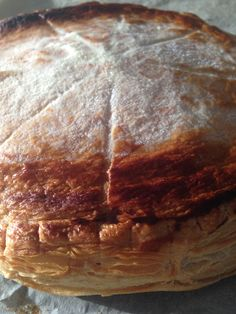 The cake traditionally celebrating Epiphany in France is called a galette des rois and consists of flaky puff pastry layers with a dense centre of frangipane.
