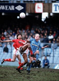 Des Walker of Nottingham Forest tussles with Coventry City's Alan Brazil.