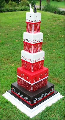 Cup a Dee Cakes' Red & Black Show Cake. Each tier is stacked on a separator that is rimmed with beaded fringe.  Very striking.