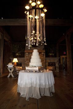 flowers hanging above the cake (photo by melissa schollaert, event planning   by honey darling events)