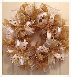 This beautiful White and Gold Deco Mesh Wreath will add festive elegance to your home or to any wedding venue.  It is made with high quality white and gold metallic deco mesh.  There are metallic poke a dot gold ribbons, silky white ribbons with glittered gold and swirl ribbons.  Gold flex tubing with glittered gold springs and picks have been placed all around the wreath.  It measures 25 inches and can ship out within 2 to 5 days of purchase.  Order early for best availability--  Thanks for…