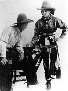 Rodeo legend Fannie Sperry Steele, right, and her husband, Bill Steele, are pictured in 1916, posing with the belt and solid gold buckle that she won in Kansas City. Fannie is wearing her trademark calfskin split riding skirt.