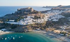 Rhodes Holidays - 10 Reasons to Travel to the Island of the Knights! Golden sandy beaches with crystal clear waters and pine-covered mountains. Rhodes Island Greece, City From Above, Crystal Clear Water, Medieval Town, Archaeological Site, New City, Sandy Beaches, Historical Sites, Rhode Island