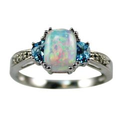 Opal with sapphires Ring. I'm not a diamond girl so this would be a perfect engagement ring. It combines my birthstone with his...