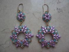Orecchini Meredith realizzati con superduo, cristalli e rocailles. #earrings #superduo #rocailles #beads #orecchini #handmade