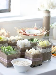 Dreamy white, soft pink, gold and taupe party for a 1st birthday. Great details including crudites served in glass cubes decorated with burlap fabric ribbon.