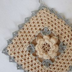 handmade floral potholder from vintage pattern (champagne and silver sparkle)
