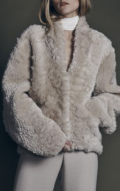 This **Hellessy** Harold alpaca shearling bomber jacket features a wide lapel and an oversize boxy silhouette.