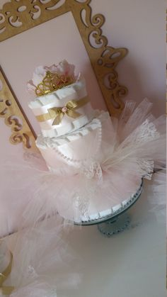 You will receive : - 65 Pampers Swaddlers Size 2 -1 handtied tutu photo prop for baby size NB and up - Couture Peony and Luxury Double Faced Satin Ribbon The complete set with 2 accent cakes can be purchased below at this link: https://www.etsy.com/listing/253454861/baby-shower-decorations-girl-complete?ref=listing-shop-header-0 Contact me with multiple orders for shower table centerpieces (yes, I do make multiples of many of my cakes) so long as I have ample n...