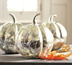 'Looking glass' spray can transform pumpkins into these gorgeous centerpieces! Use a white spray first to get the best effect. Try this with dollar store pumpkins.