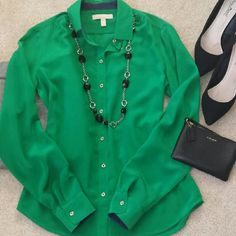 """*Beautiful 100% Silk Banana Republic Blouse* *I love everything about this blouse!! The green/blue combo is perfect w/the gold buttons (Picture 2 & 3). The 100% silk material feels amazing & perfect for spring weather. Great for business, business casual or paired with favorite jean kinda day. Underarm-underarm measurement is 18"""", length is 21"""". In great condition.  Ask any questions. Happy Poshing!!* Banana Republic Tops Blouses"""