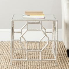 @Overstock - The Rory accent table?s chic mirrored top and Chinoiserie-inspired silver leaf faux bamboo base in forged iron boast classic style with a refined, modern edge.http://www.overstock.com/Home-Garden/Safavieh-Treasures-Rory-Silver-Mirror-Top-Accent-Table/7896404/product.html?CID=214117 $181.99