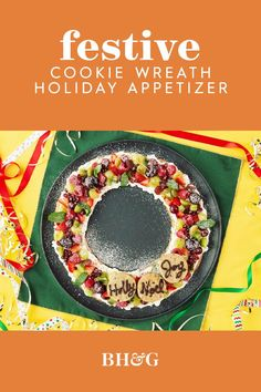 This Christmas dessert is sure to be devoured! Use store-bought sugar cookie dough to create a giant cookie wreath! A sprinkling of seasonal fruits and a few smaller decorated Christmas cookies that look like ornaments add all the eye-catching appeal you need. #giantsugarcookie #christmasdessert #holidayrecipes #fruitpizza #bhg