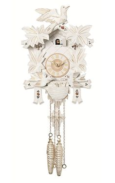 This beautiful #German #cuckoo #clock features wooden hands, a wood dial with Roman numerals, and a warm light yellow hand-painted and hand-carved cuckoo bird. The white cuckoo clock case is surrounded by four deeply carved painted maple leaves with a single hand-carved bird seated at the peak of the roof.