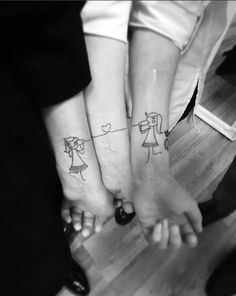 Mother and daughter tattoos by Liga