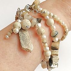 A breathtaking gemstone wrap bracelet in freshwater pearls, silver leaf jasper, and African opal stone that goes from season to season, and year to year with pure natural beauty. Only one of this design available! Aromatherapy Jewelry, Jasper, Natural Beauty, Opal, Beaded Bracelets, African, Pure Products, Gemstones, Pearls