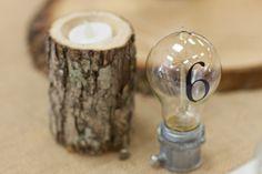 light bulb table numbers, photo by Kelsea Holder http://ruffledblog.com/cambria-pines-lodge-wedding #weddingideas #tablenumbers #diy