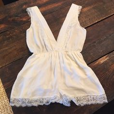 PRICE DROP!!! Cream with lace romper Never worn.  Very Cute low cut ivory romperz. Very low cut V in the front and back.  The bottom half is fully lined.  Has front pockets. Honey Punch Other