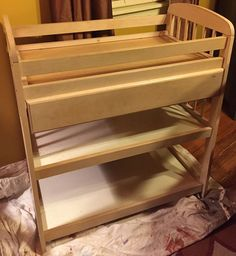 Incredible how she transformed a diaper change table into a bar.