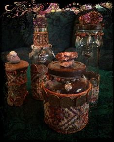 This is an Earth Magick bottle set of Four Bottles.. These bottles are designed to hold Herbs, Spell ingredients or spells. The design and symbols on the bottles was chosen to enhance and invite the Earth Elemental's energy. They are all adorned with pennies, symbolizing the metal Copper. On top of each bottle is a different type of stone, all stones are used to draw the Earths energies.