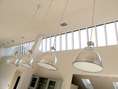 SGS Design Ltd design for an old Dairy.  BTC Titan pendant lights hanging in converted dairy