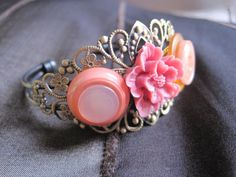 http://www.etsy.com/listing/82191443/fall-colors-on-filigree-bracelet-with?ref=sr_gallery_1&ga_search_submit=&ga_search_query=coral+jewelry&ga_view_type=gallery&ga_ship_to=US&ga_page=194&ga_search_type=handmade&ga_facet=handmade