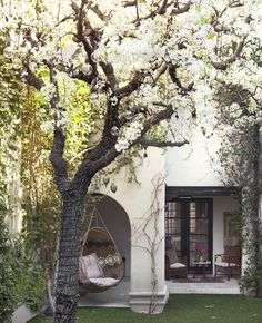Estee Stanley, Beverly Hills home of Hedi Gores | outdoor chair swing