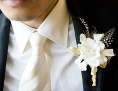 White Boutineer with a Twist  Ivory shirt, Fancy ivory tie, ivory floral with black and ivory feather.